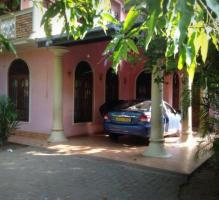 Two storied house with 4 bed rooms and two bathrooms!!has a land area of 12 perches including the ga